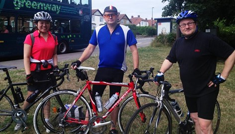 Jing, Steve and Barry getting on their bikes for Pedal to Paris training ride