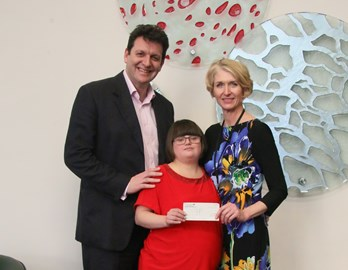 Alice presenting a cheque to the Sussex Heart Charity