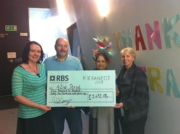 Presenting 42nd Street with a cheque from Kieran Fest 2013