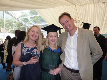 Miche at graduation with her mum and dad