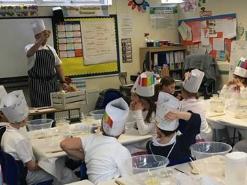 Josh teaching the kids about bread!