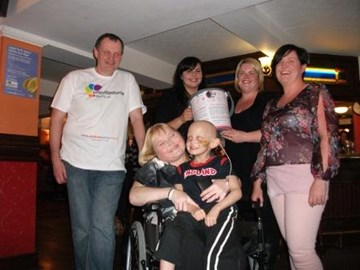 Logan at quiz night by co-op funeralcare