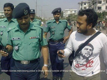 William Gomex interviews police in Dhaka