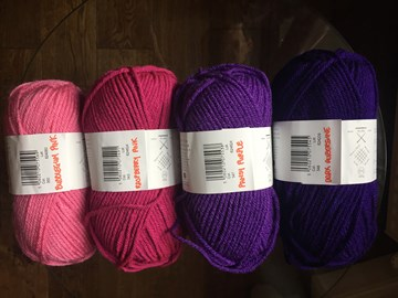 I have a great selection of yarn in various shades of pink and purple