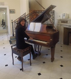 Playing the piano at the GcMAF clinic in Switzerland ... a 1924 Steinway