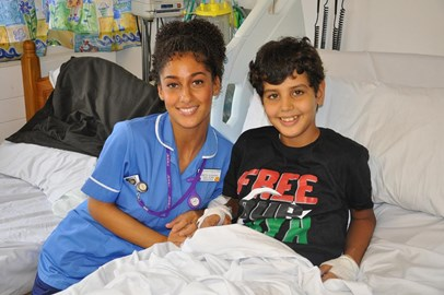 Abdul with Paediatric Nurse, Monette