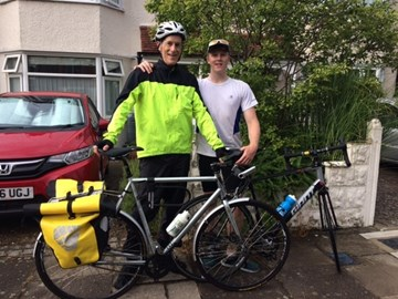 Second Leg - my son and I after cycling from Colchester to London in a thunderstorm; one of us was sensible.