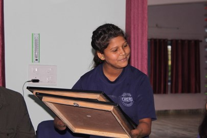 Pupil at the JSR school. She lost both hands in an accident but has learned to paint holding the brush in her mouth!