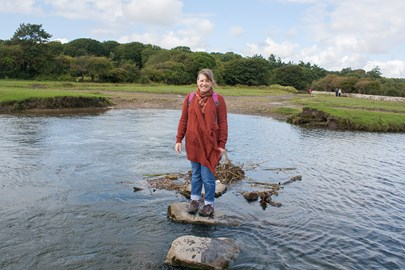 Jackie on stepping stones near Ogmore Castle