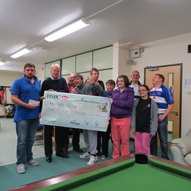 Handing over the money you helped to raise last year to Monday Club.