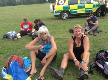 Lyn and I taking a well earned break to eat, drink and change socks