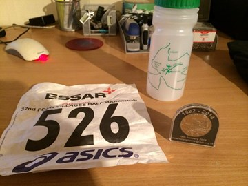 Medal and gift from 4 Villages Half Marathon 2014