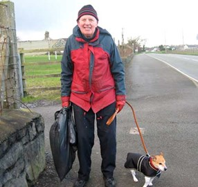 Geoffrey, who picks up litter every day in Bontnewydd with his dog Joe.
