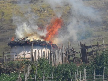 A torched Sengwer home