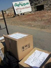 Parenting leaflets being taken across the border from Turkey to Syria