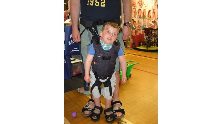 Jake trying out some potential new equipment - to help build the muscles needed to stand and walk