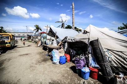 "A small part of ""Tent City"" where 31,000 people still live in unsanitary, unsafe conditions"