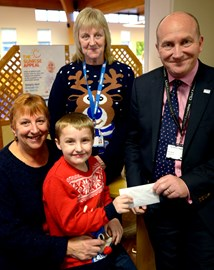 Oliver and his Grandmothers giving Nick Hulme the first donation