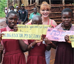 Michaela with children from the Starchild schools