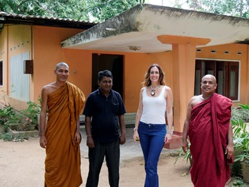 Outside the house that the monks are buying for an orphanage