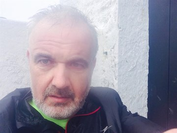 The lowest point, and the toughest part of the event. Driving wind and rain and after 52km, at the top of Croagh Patrick.