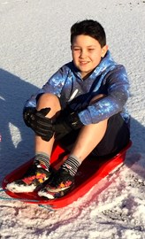 Its chilly but sledging in the snow keeps me active and warm!