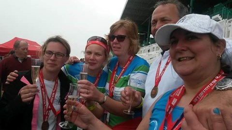 Me with my pals at the finish line enjoying a glass of bubbles.
