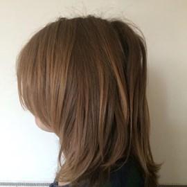 Thom's long hair