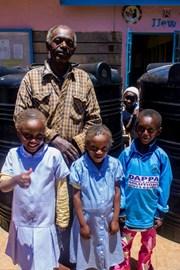 Bobo, Bernard and Alena's father receiving a water tank