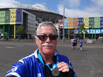 "At Amsterdam Arena with finisher's ""medal"""