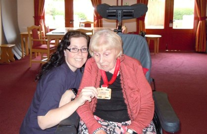 Me and my gran with our medal.
