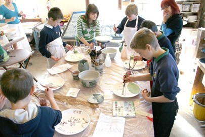 Local children painting their plates