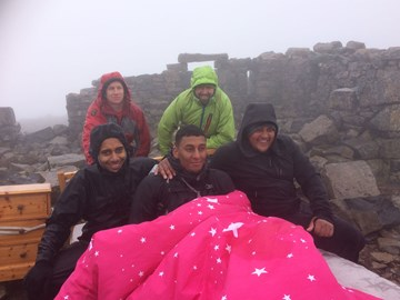 The team getting comfy at the top!