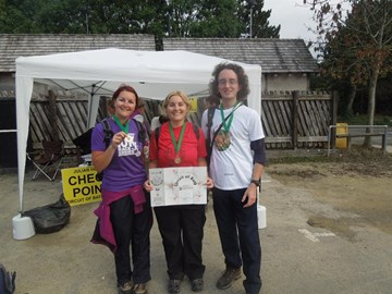 That's me on the right, with two friends at the end of the walk, having received our hard-earned and well-deserved medals.