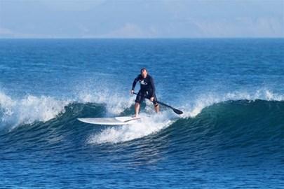 Simon Bassett Stand Up Paddle Surfer