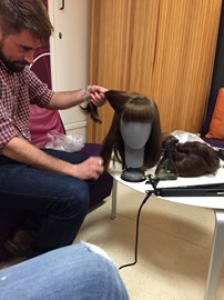 Katie's wig being styled