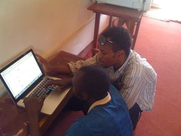 Congolese men learning English with my laptop