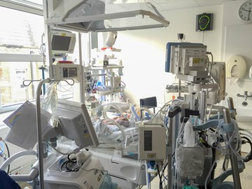 Mikaere with all his monitoring equipment in the NICU