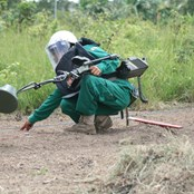 A highly-trained MAG deminer working at a clearance site in Cambodia