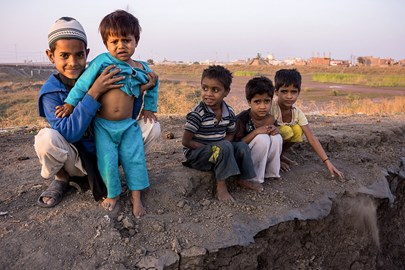 Toxic playground: Boys play near their homes with the abandoned Union Carbide factory in their back yard. © Bhopal Medical Appeal