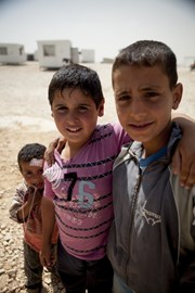Omar Mohamed, 10, (centre) with friends.Omar's family have fled the conflict in Syria and are now living as refugees in Jordan's Zaatari camp.