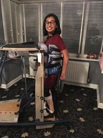 Shuhaney in her standing frame
