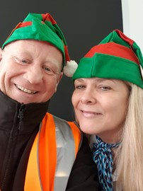Excited elves as their hats arrive for the Santa dash