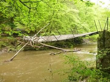 the storm damaged suspension bridge