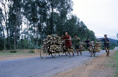 Vietnamese pushing bikes along the Trail