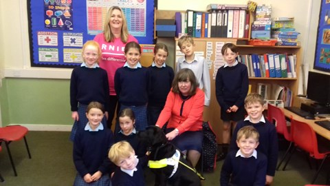 Jackie Brown and guide dog, Annie, recently visited our school. Jackie talked about her life as a cook at Belhaven Hill before losing her sight.