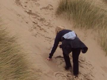 Me struggling up a sand dune !