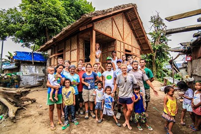 All Hands Volunteers with the family, from Barangay 83-C, moving into their new permanent core house