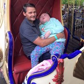 Holly had never been on a ride, we made it possible to ride in the princess carriage on her Dads lap
