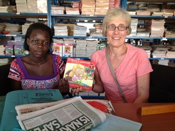 Buying books in Kampala